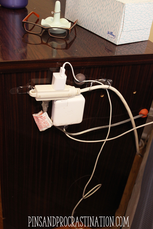 Is your bedside a tangle of jumbled cords? I have 3 different chargers, a lamp, and an extension cord all right there, and they really turn into a mess. That's why I came up with this easy cord organization solution! If you want neat cords, just read this to find an easy tutorial on how to organize your cords.