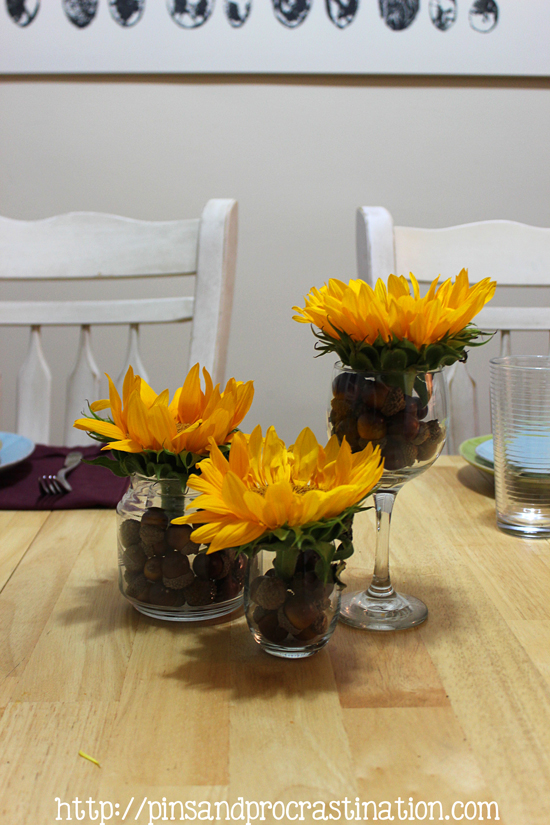 Looking for thanksgiving centerpiece ideas? Here are 4 different thanksgiving centerpieces you can use! All are absolutely lovely. They use sunflowers, pumpkins, gourds, and acorns! The perfect combinations for great thanksgiving centerpieces. If you need some inspiration this thanksgiving you should definitely check these out.